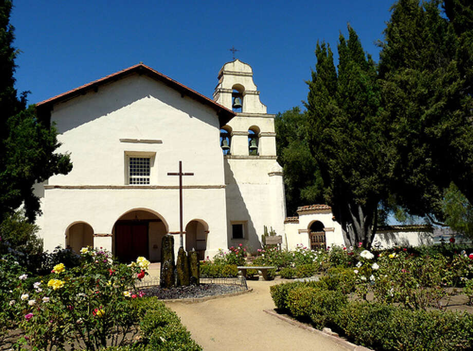 "Vertigo: Mission San Juan Bautista was featured in Alfred Hitchcock's movie ""Vertigo."" The mission's bell tower is shown often during the movie, and it's where one of the main character falls to her death. (Photo: Rachel_Titiriga, Flickr) Photo: (Photo: Rachel_Titiriga,  Flickr)"