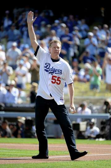 LOS ANGELES, CA - OCTOBER 16:  Orel Hershiser reacts before he throws out the ceremonial first pitch