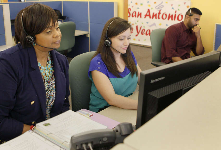Rovena Flaggs (left) trains Stacey Lara at San Antonio Marriott Global Reservation Sales and Customer Care. The call center has won many awards since 1999, including second, third and fourth place for Top Workplace. Photo: Cynthia Esparza / For The Express-News