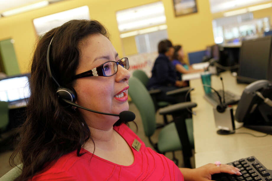 Azenet Hernandez takes a call Oct. 4, 2013 at San Antonio Marriott Global Reservations & Customer Care. The call center has about 600 employees working there and has won many awards since 1999 when they started there, including awards for Top Workplaces.
