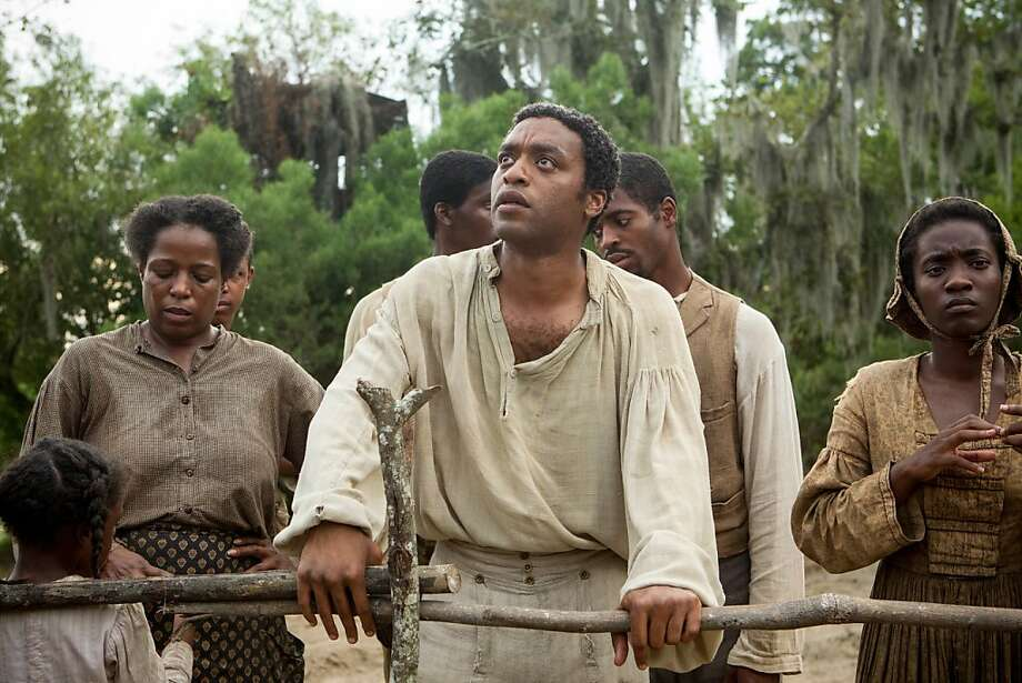 "Chiwetel Ejiofor plays Solomon Northup, a free man living and working in New York state who was kidnapped  and sold into slavery in 1841, in director Steve McQueen's harrowing drama ""12 Years a Slave,"" based on a memoir by the real-life Northup. Photo: Fox Searchlight"