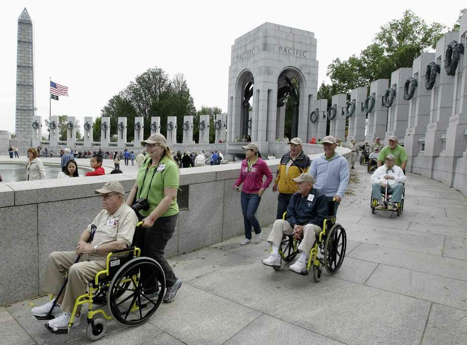 A reader praises veterans for showing up at the World War II Memorial despite the government shutting it down. These World War II veterans from Florida visited the site last week. Photo: Luis M. Alvarez / Associated Press