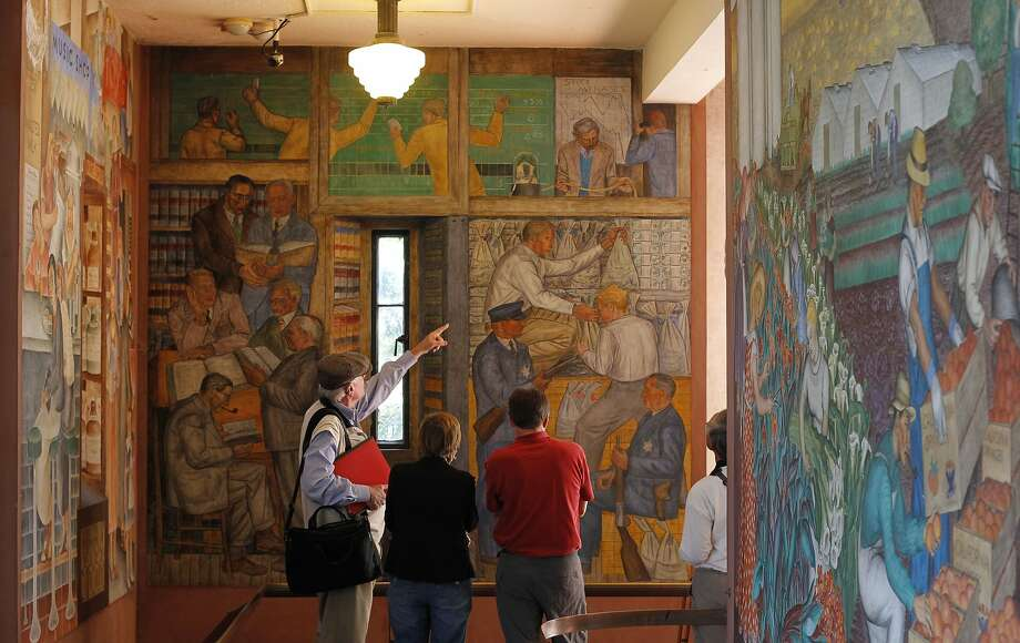 Visitors admire the storied murals that cover the walls of 80-year-old Coit Tower. They'll be part of its restoration. Photo: Michael Macor, The Chronicle