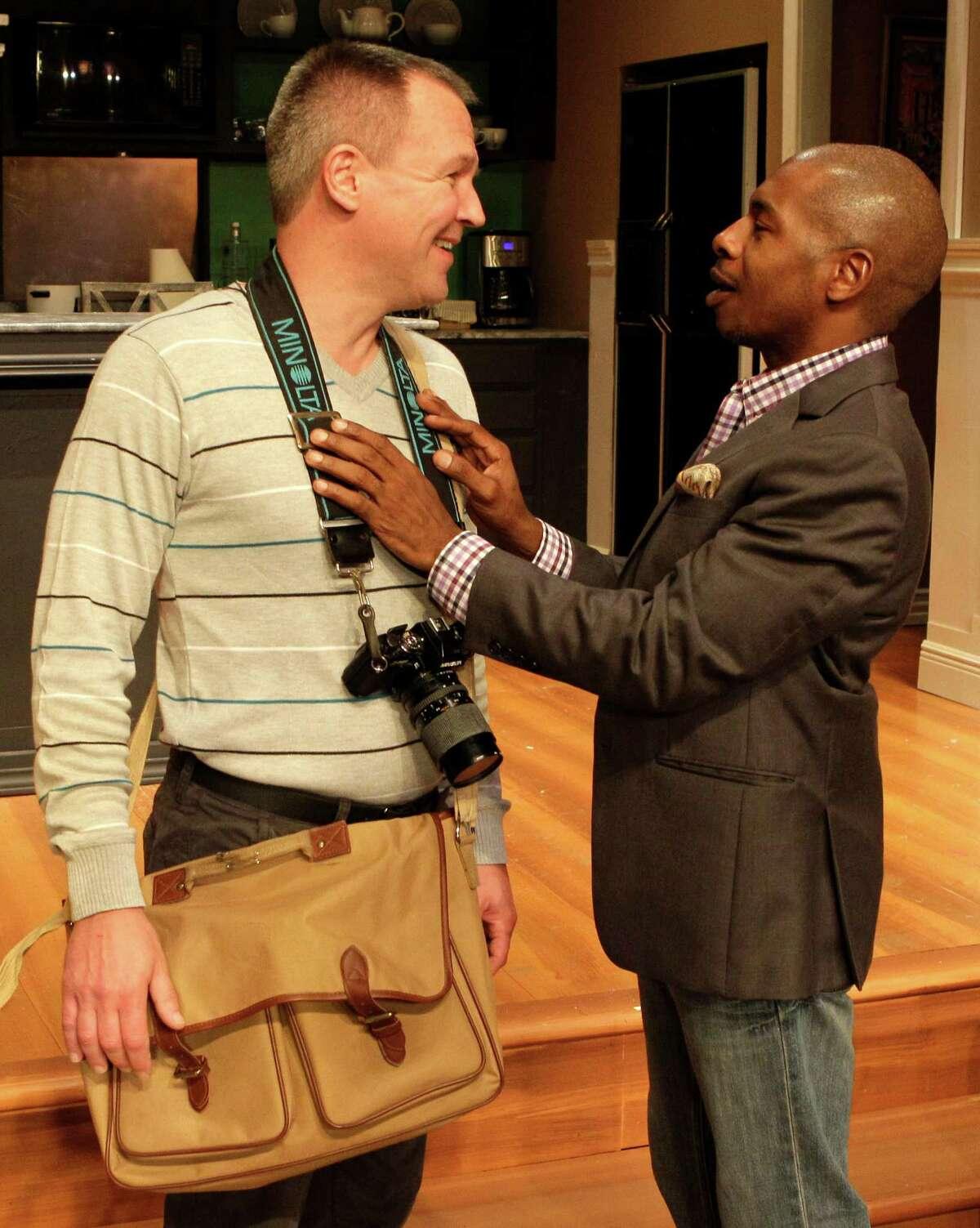 """Steve Bullitt, left, and Adrian Porter perform in the Ensemble Theatre's production of """"Immediate Family."""""""