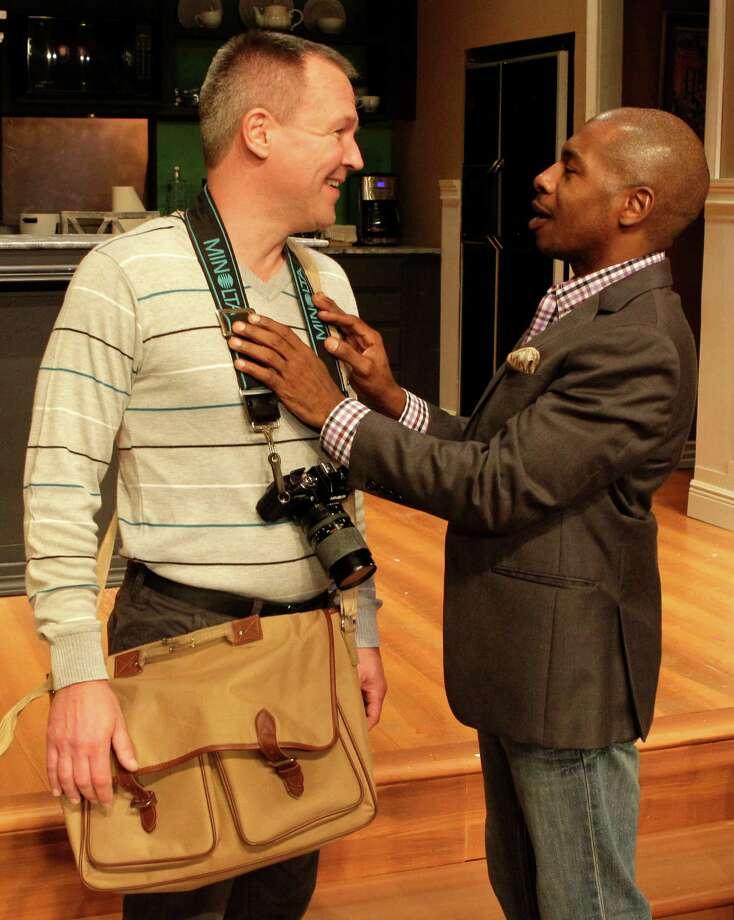 "Steve Bullitt, left, and Adrian Porter perform in the Ensemble Theatre's production of ""Immediate Family."" Photo: Melissa Phillip, Staff / © 2013  Houston Chronicle"