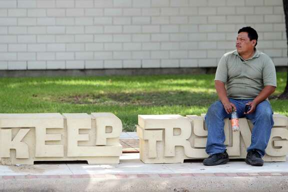 Jose Escobar sits on street art placed at the bus stop as part of the Navigation Boulevard Esplanade on Tuesday, Aug. 20, 2013, in Houston. The esplanade along Navigation Boulevard is between N. St. Charles Street and N. Paige Street which is meant to be an attraction for local residents and tourists of the East End. ( Mayra Beltran / Houston Chronicle )