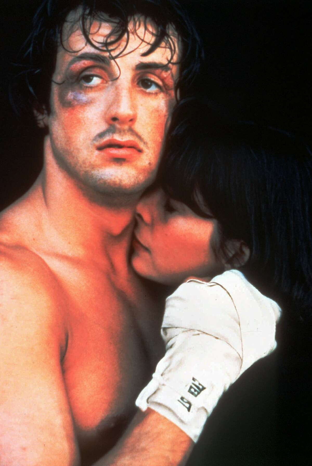 ** FOR USE WITH AP WEEKLY FEATURES ** Sylvester Stallone and Talia Shire are shown in a scene from the 1976 film ``Rocky,'' which is included in the top 100 movies in ``The New York Times Essential Library: Children's Movies'' (Henry Holt and Company) by Peter M. Nichols. (AP Photo/Files). HOUCHRON CAPTION (12/18/2004) SECSTAR COLOR: TOUGH LOVE: Sylvester Stallone and Talia Shire fought their way through five ``Rocky'' films.