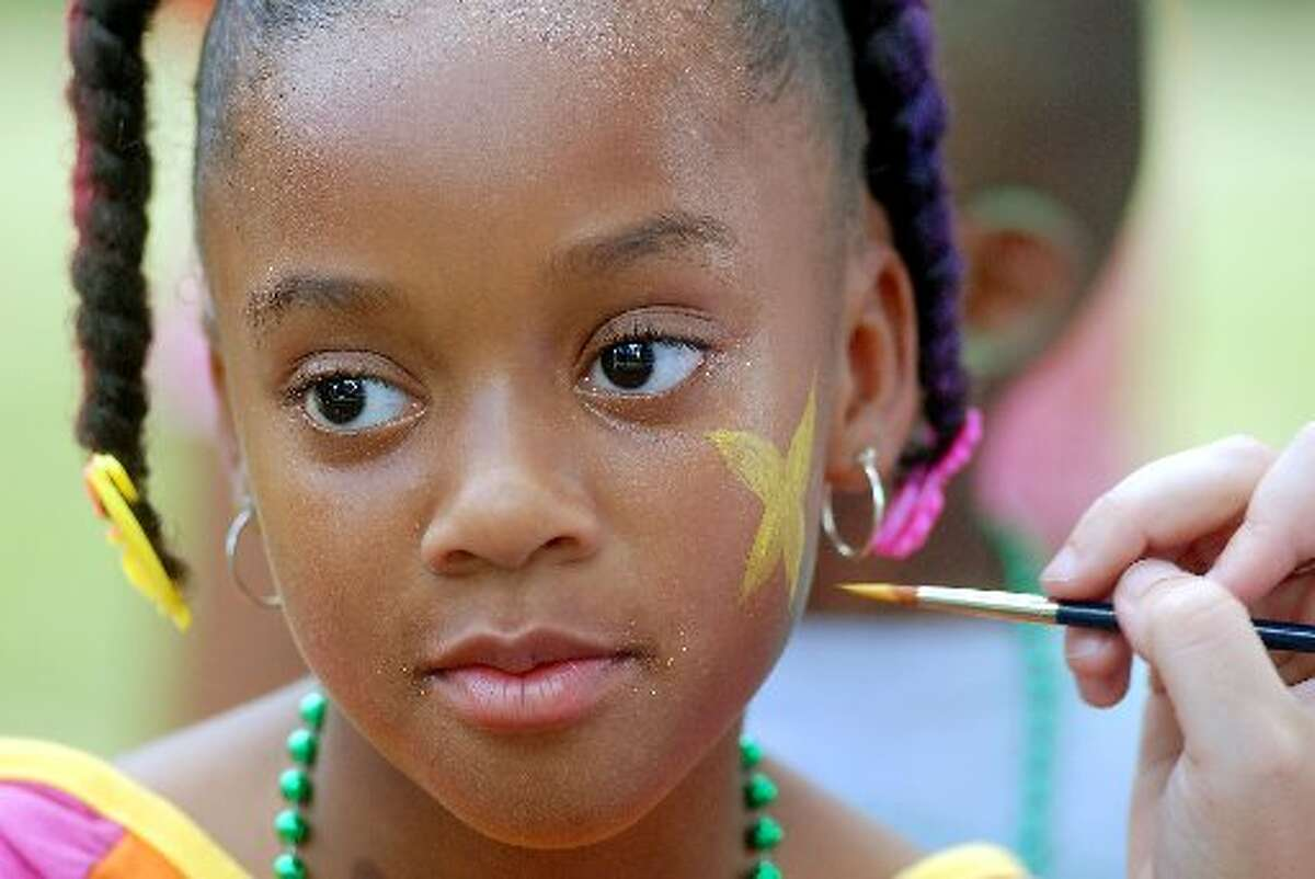 Destiny Hopes, 8, (77086) has her face painted at the KBR Kids Day on Buffalo Bayou downtown Saturday June 14,2008. (Dave Rossman/For the Chronicle)