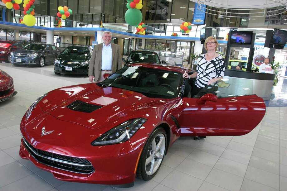 Wendy Griffith traded in her Camaro last week for a spiffy metallic red 2014 Corvette Stingray, one of the first to be delivered by Classic Chevrolet in Sugar Land. Her husband, Steve (left), is assistant city manager of Sugar Land and a longtime law-enforcement administrator in the Houston area.