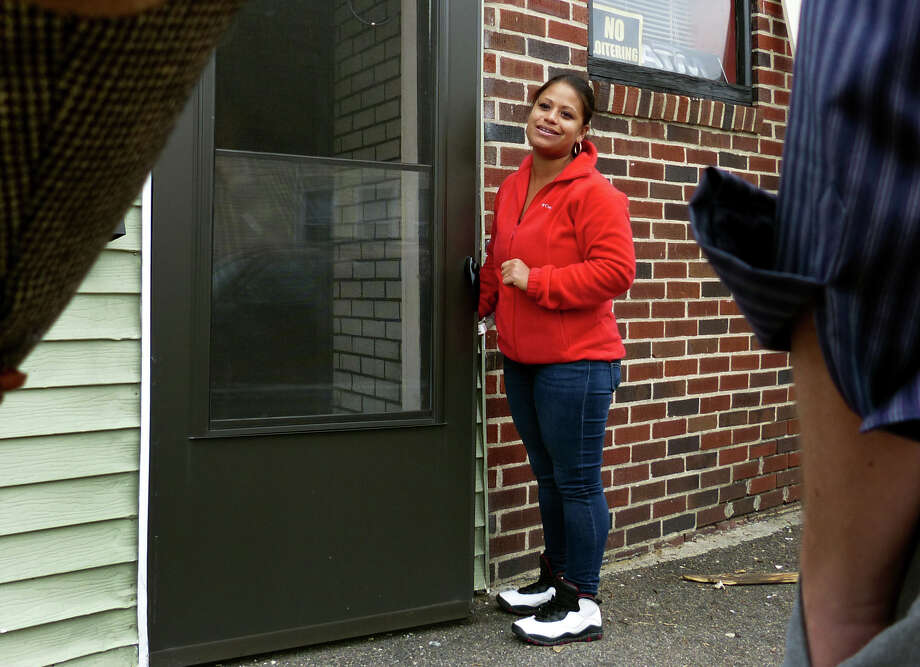 "State representative Christina Ayala stands at the doorway of Ayala's Restaurant, which is owned by her father Alberto ""Tito"" Ayala on Beechwood Avenue in Bridgeport, Conn., on Wednesday October 16, 2013. Christina Ayala refused to comment on possible criminal charges after an investigation by the State Elections Enforcement Commission. Photo: Christian Abraham / Connecticut Post"