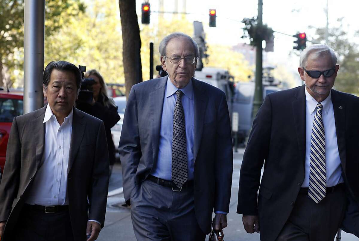 Federal mediator George Cohen, center, arrives at the Nicholas C. Petris State Building to continue with the Bay Area Rapid Transit negotiations, Wednesday October 16, 2013, in Oakland, Calif.