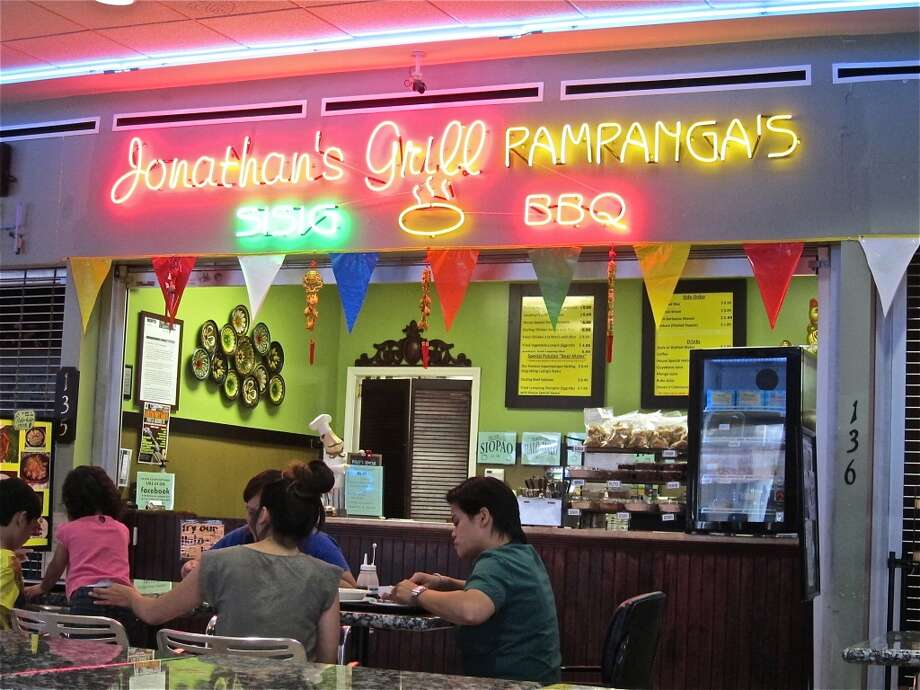 Neon signage at Jonathan's Grill, a Filipino vendor in the Viet Hoa International Food Court, Alief.