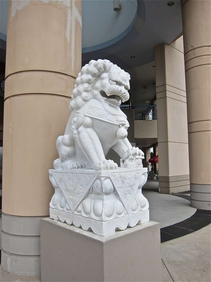 Enormous lion statues guard the entrance to the International Food Court at the Viet Hoa complex in Alief. Photo: Alison Cook