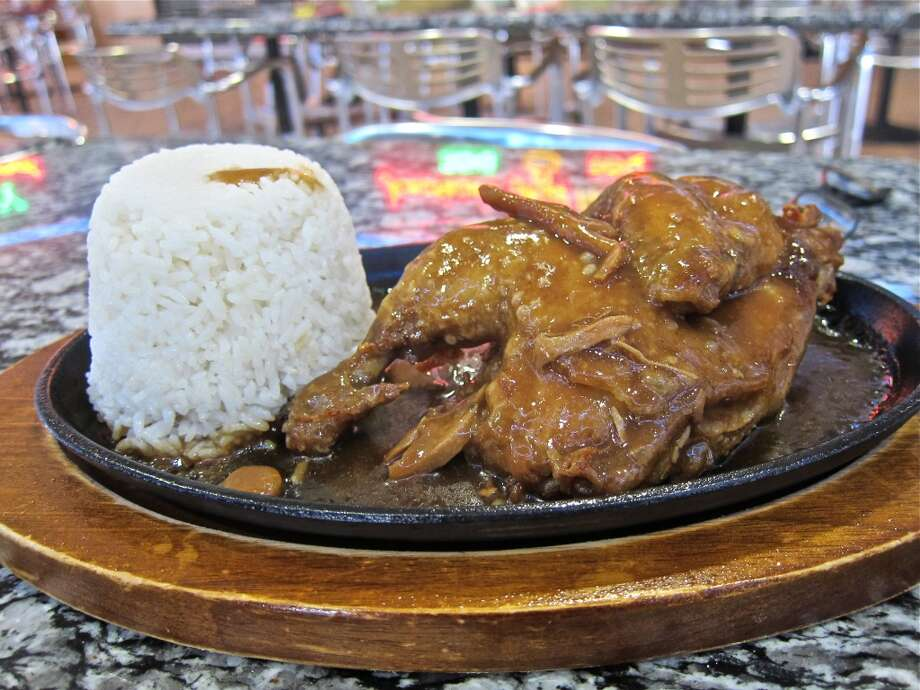 Chicken adobo with rice at Jonathan's Grill, a Filipino food vendor at the International Food Court in the Viet Hoa center. Photo: Alison Cook