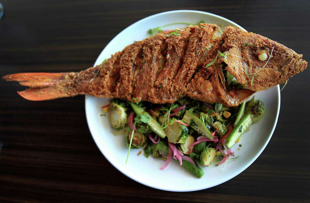 """Vermillion Snapper """"bycatch"""" fish, which is lightly fried with local vegetables, a creation of Mark Gabriel """"Gabe"""" Medina, co-exec chef of Soma Sushi on Washington, Wednesday,Oct. 9, 2013, in Houston. ( Karen Warren / Houston Chronicle )"""