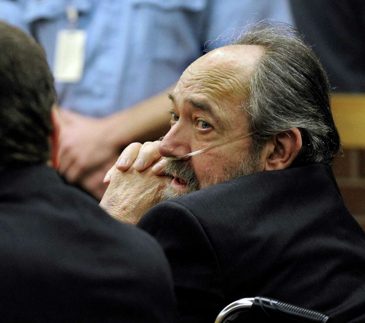 John Heath, right, with his attorney Frank O'Reilly, listens to the verdict as it is read Wednesday, Oct. 2013, at Danbury Superior Court in Danbury, Conn. Heath was found guilty in the death of his wife.