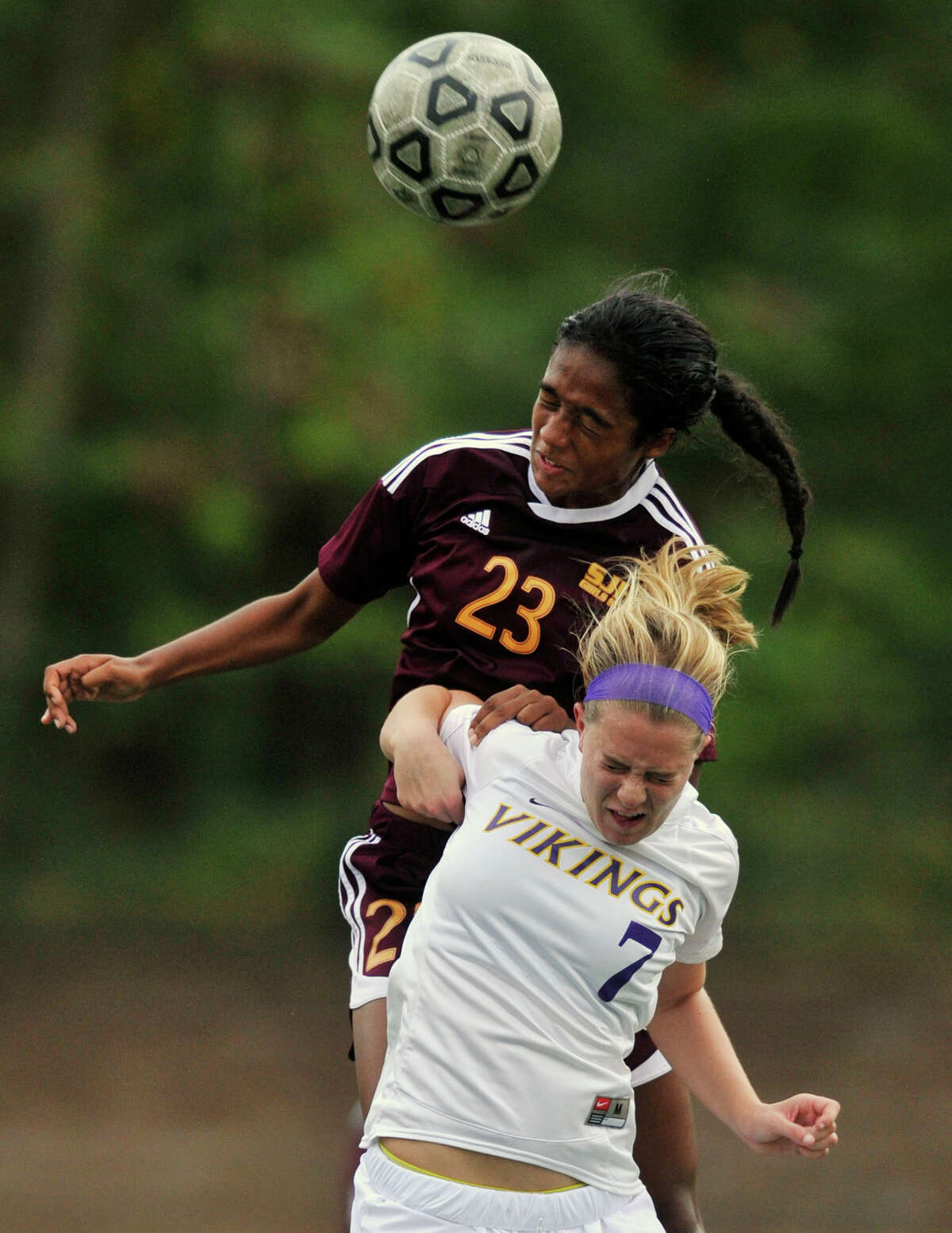 St. Joseph's Leah Lewis leaps over Westhill's Rachel Benz to get a head on the ball during their game at Westhill High School in Stamford, Conn., on Wednesday, Oct. 16, 2013. St. Joseph won, 4-1.