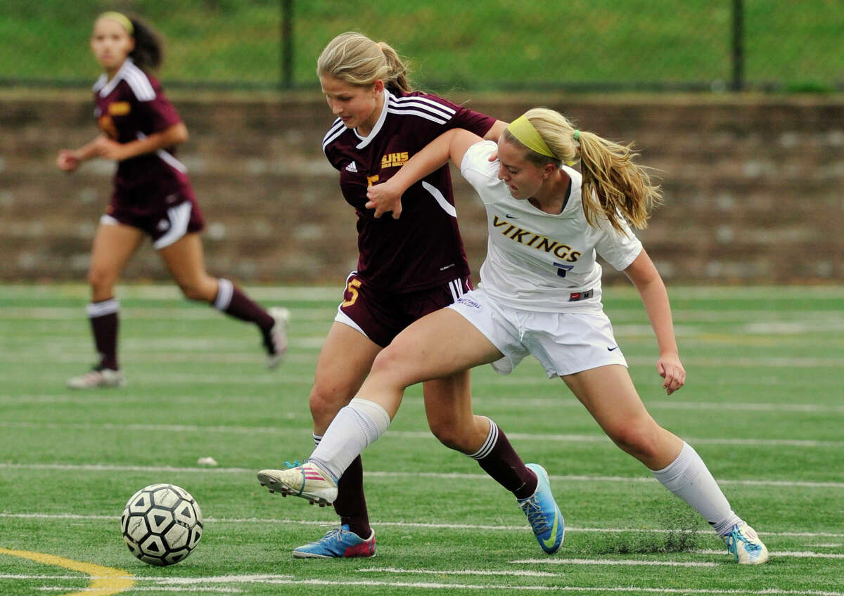 St. Joseph's Julia Marino battles Westhill's Rachel Benz for control of the ball during their game at Westhill High School in Stamford, Conn., on Wednesday, Oct. 16, 2013. St. Joseph won, 4-1.