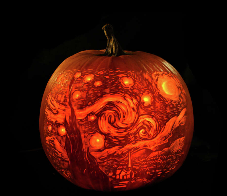 """This undated publicity photo provided by Maniac Pumpkin Carvers shows the Maniac Pumpkin Carvers' interpretation of """"Starry Night,"""" by Vincent van Gogh, which was gifted to the Museum of Modern Art in New York City, where it was displayed in the lobby last Halloween.  For at least three months each Fall, pumpkin carvers Marc Evan and Chris Soria, of New York City, relinquish their illustrator occupations to carve fantastical pumpkins full-time to become the Maniac Pumpkin Carvers. (AP Photo/Maniac Pumpkin Carvers, Marc Evan) Photo: Marc Evan, Associated Press / Maniac Pumpkin Carvers"""