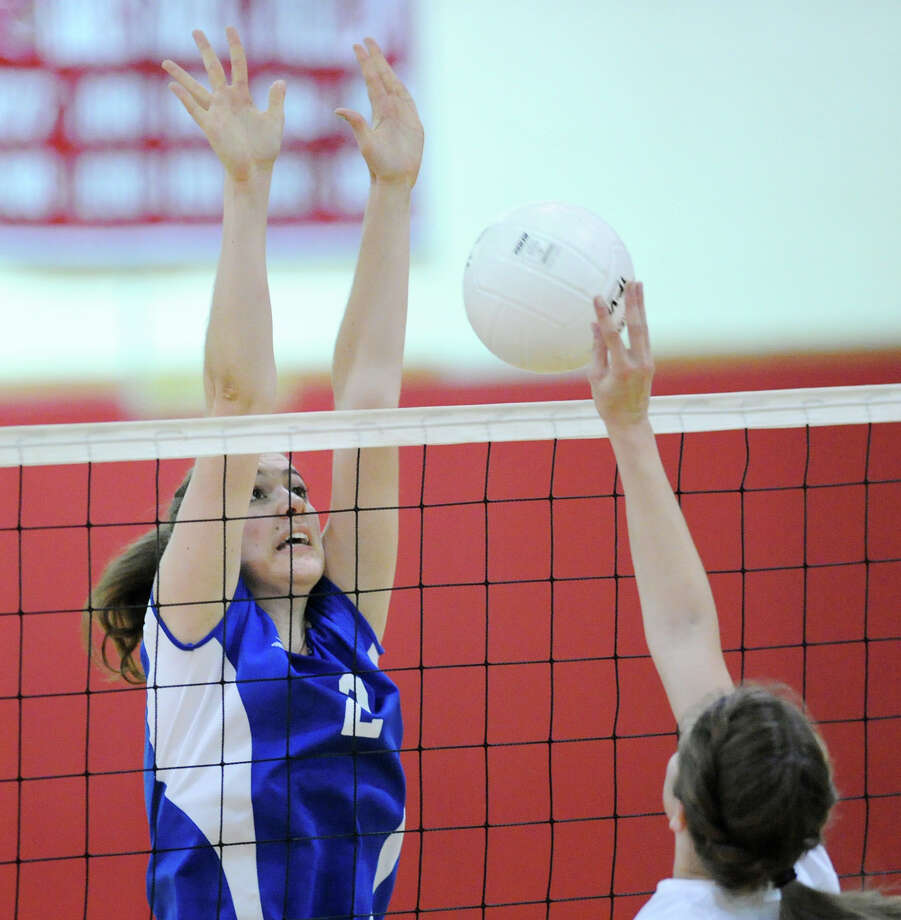 Fairfield Ludlowe's Casey Boatwright (# 2) blocks a Greenwich spike during the girls high school volleyball match between Greenwich and Fairfield Ludlowe at Greenwich, Wednesday, Oct. 16, 2013. Photo: Bob Luckey / Greenwich Time