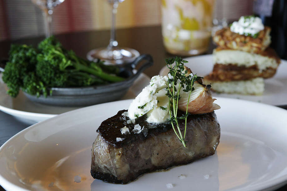 The 12-ounce New York strip steak is one of the offerings at 18 Oaks at the JW Marriott San Antonio Hill Country Resort & Spa. Photo: Express-News File Photo