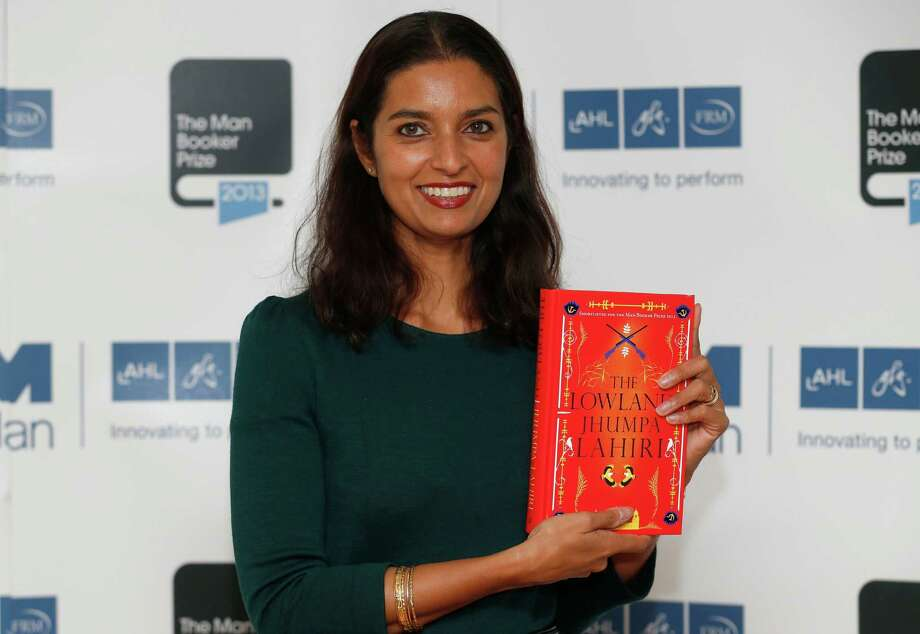 FILE - In this Oct. 13, 2013 file photo, author Jhumpa Lahiri poses with her book 'The Lowland' in London.  Lahiri, Thomas Pynchon, and George Saunders were among the finalists Wednesday, Oct. 16, 2013 for the National Book Awards. A month after releasing long-lists of 10 in each of the four competitive categories, the National Book Foundation announced the five remaining writers for fiction, nonfiction, poetry and young people's literature. Winners receive $10,000 and will be announced at a dinner ceremony in Manhattan on Nov. 20. (AP Photo/Sang Tan) Photo: Sang Tan, STR / AP