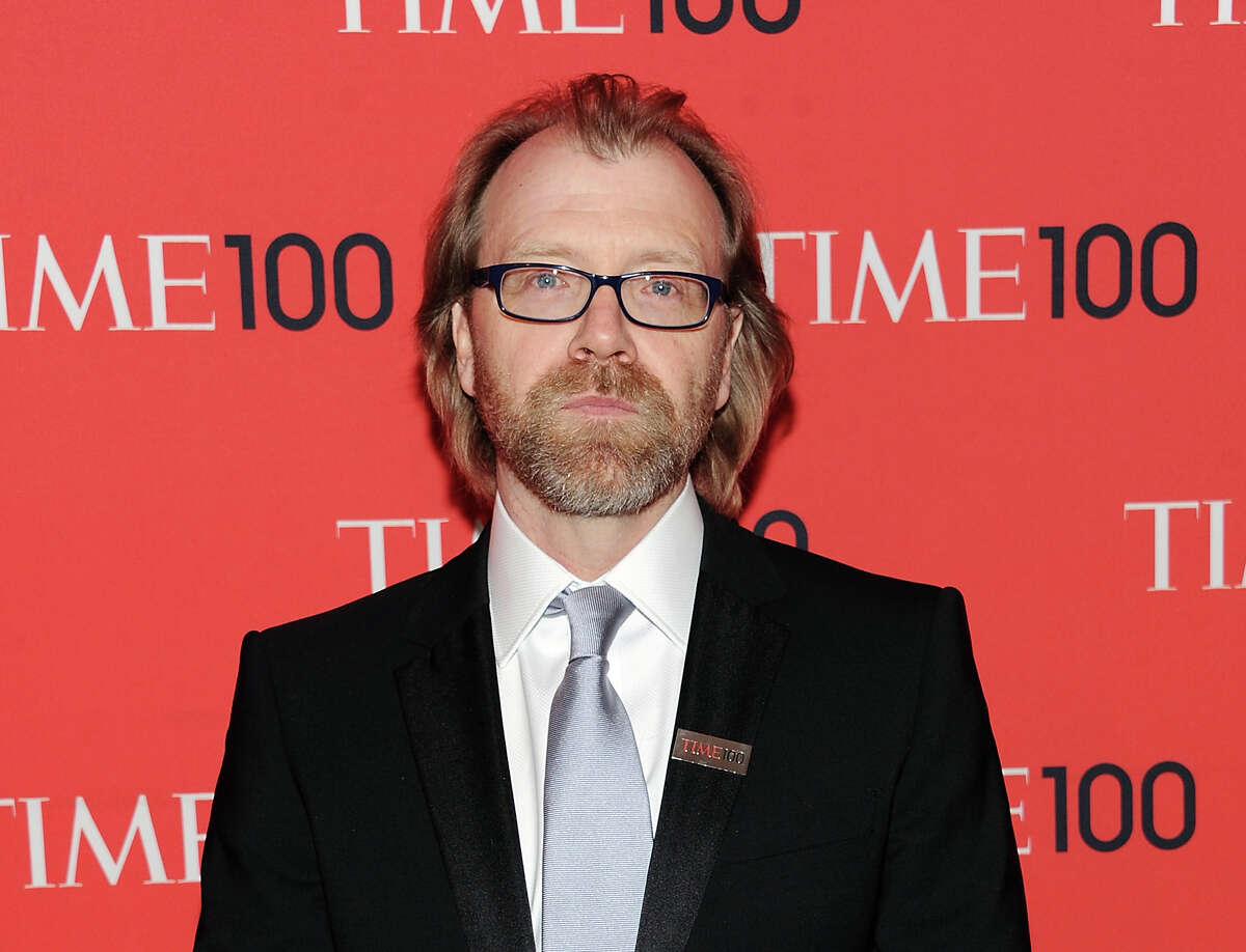 """FILE - This April 23, 2013 file photo shows writer George Saunders at the TIME 100 Gala celebrating the """"100 Most Influential People in the World"""" in New York. Saunders, Thomas Pynchon, and Jhumpa Lahiri were among the finalists Wednesday, Oct. 16, 2013, for the National Book Awards. A month after releasing long-lists of 10 in each of the four competitive categories, the National Book Foundation announced the five remaining writers for fiction, nonfiction, poetry and young people's literature. Winners receive $10,000 and will be announced at a dinner ceremony in Manhattan on Nov. 20. (Photo by Evan Agostini/Invision/AP, File)"""