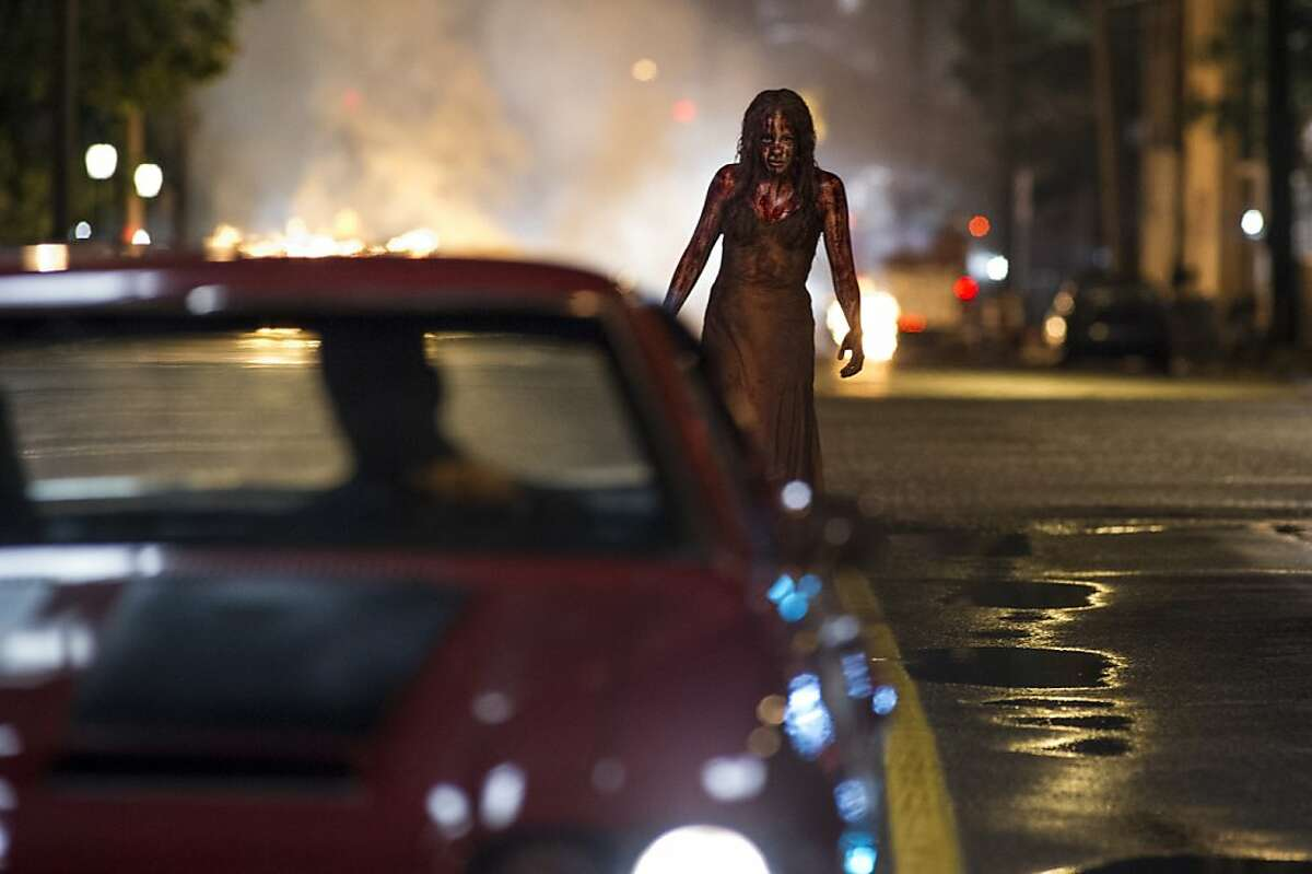 Chloe Moretz and Alex Russell (in car) in Metro-Goldwyn-Mayer Pictures and Screen Gems' horror thriller CARRIE.