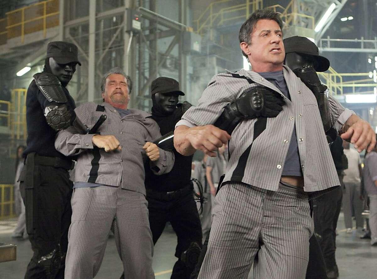 ESCAPE PLAN Arnold Schwarzenegger, Sylvester Stallone Ph: Steve Dietl © 2013 Summit Entertainment, LLC. All rights reserved.