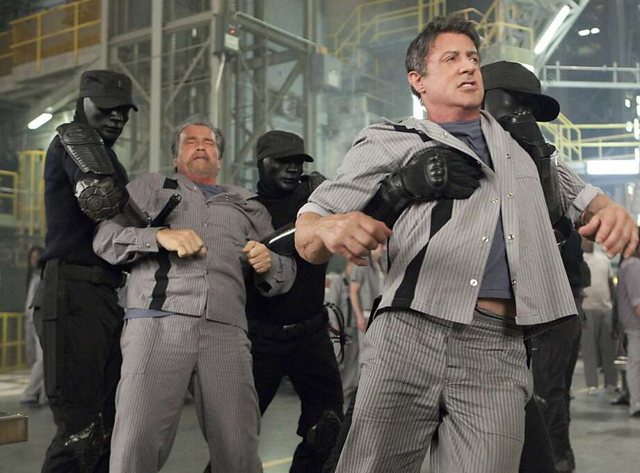 ESCAPE PLAN Arnold Schwarzenegger, Sylvester Stallone   Ph: Steve Dietl  © 2013 Summit Entertainment, LLC.  All rights reserved. Photo: Steve Dietl, Summit Entertainment