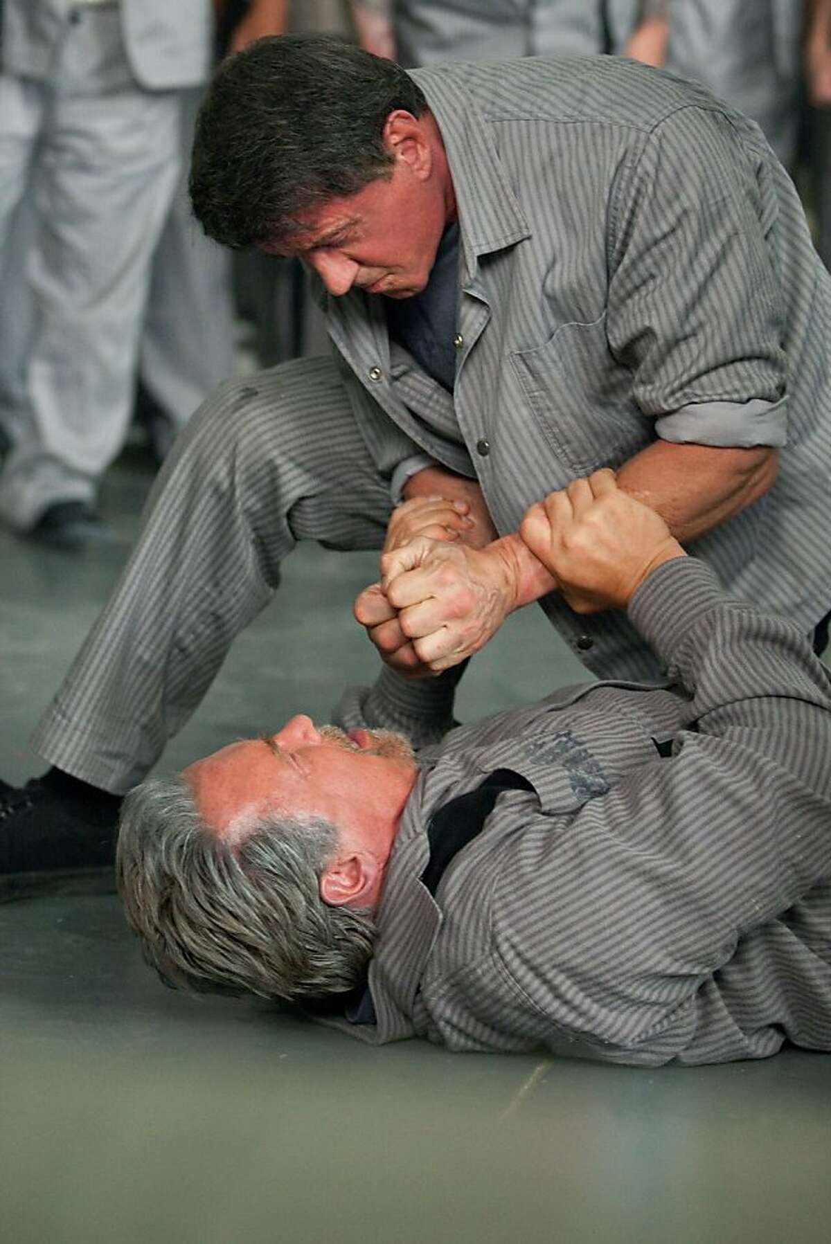 Sylvester Stallone and Arnold Schwarzenegger star in ESCAPE PLAN Ph: Alan Markfield © 2013 Summit Entertainment, LLC. All rights reserved.