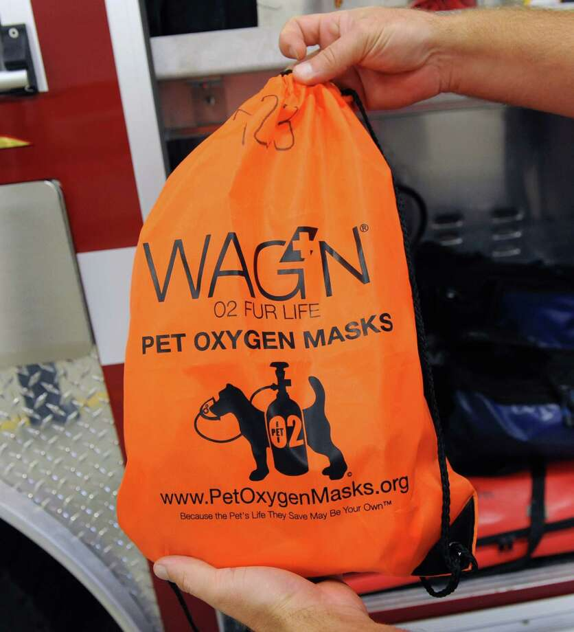 A WagON 02 Fur Life Program bag from a City of Cohoes Fire Department truck on Tuesday, Oct. 16, 2013 in Cohoes, N.Y. Each fire truck in the City of Cohoes is fully equipped with WagON pet safety gear. The kit includes oxygen masks and oxygen air tubes of various sizes to accommodate all pets.  (Lori Van Buren / Times Union) Photo: Lori Van Buren / 00024233A