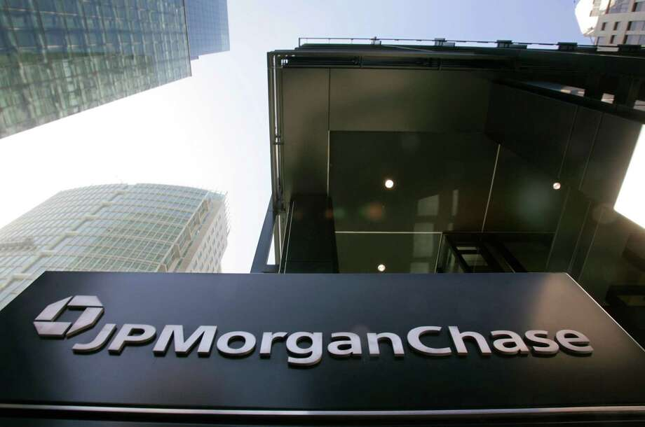 "FILE - This Oct. 15, 2008, file photo, shows the exterior view of JPMorgan Chase offices in San Francisco. In a settlement announced Wednesday, Oct. 16, 2013, JPMorgan Chase & Co., has agreed to pay a $100 million penalty and admitted that it ""recklessly"" distorted prices during a series of London trades that ultimately cost the bank $6 billion in losses. (AP Photo/Paul Sakuma, File) ORG XMIT: NY122 Photo: Paul Sakuma / AP"
