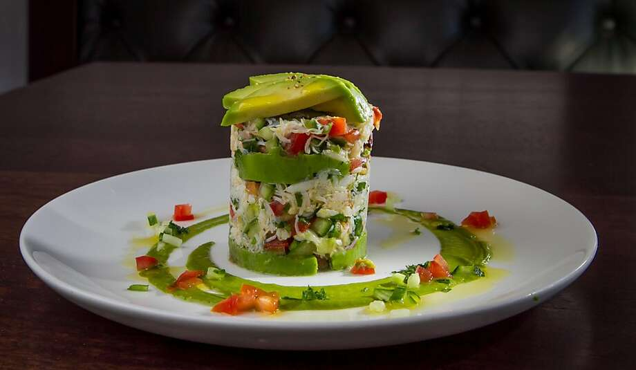 The Dungeness Crab-Meat Tower has chunks of lump crab mixed with creamy hunks of avocado, diced tomatoes, cucumber, basil. Photo: John Storey, Special To The Chronicle