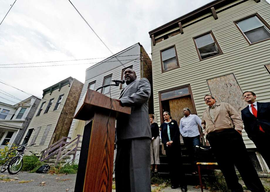 Sam Coleman received endorsements from local elected officials on Oct. 16, 2013 before he spoke in front of three derelict houses on Third Street. in Albany, N.Y.       (Skip Dickstein/Times Union archive) Photo: SKIP DICKSTEIN / 00024288A