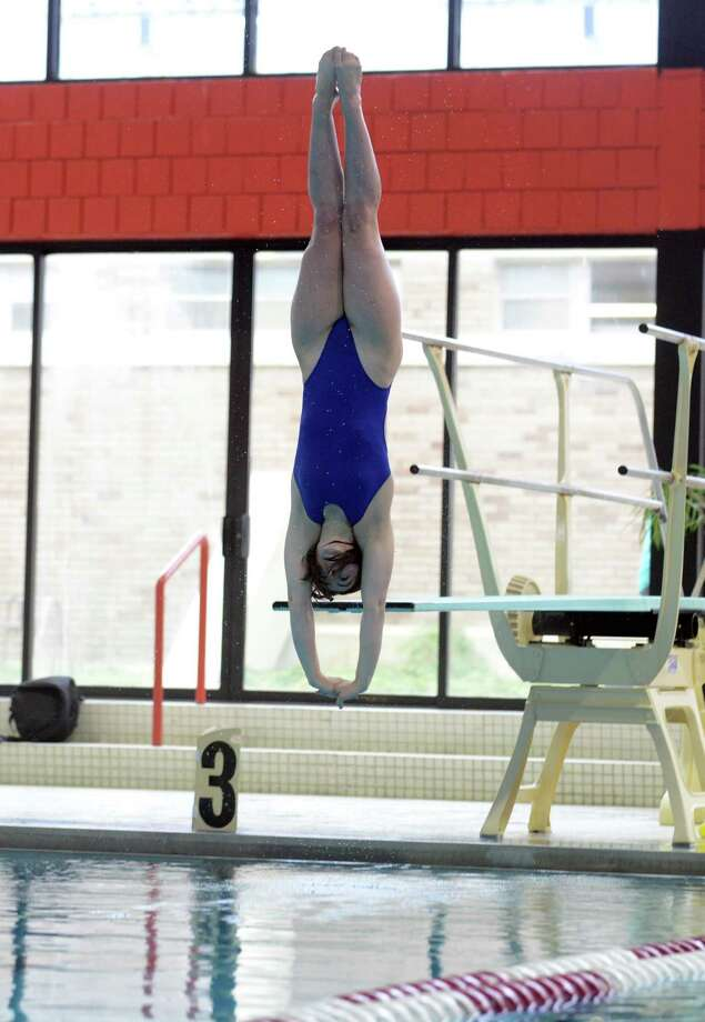 Fairfield Ludlowe's Kelsey Tague competes in the diving portion of Wednesday's swim meet with Fairfield Warde at Fairfield University Recplex Pool. Photo: Autumn Driscoll / Connecticut Post