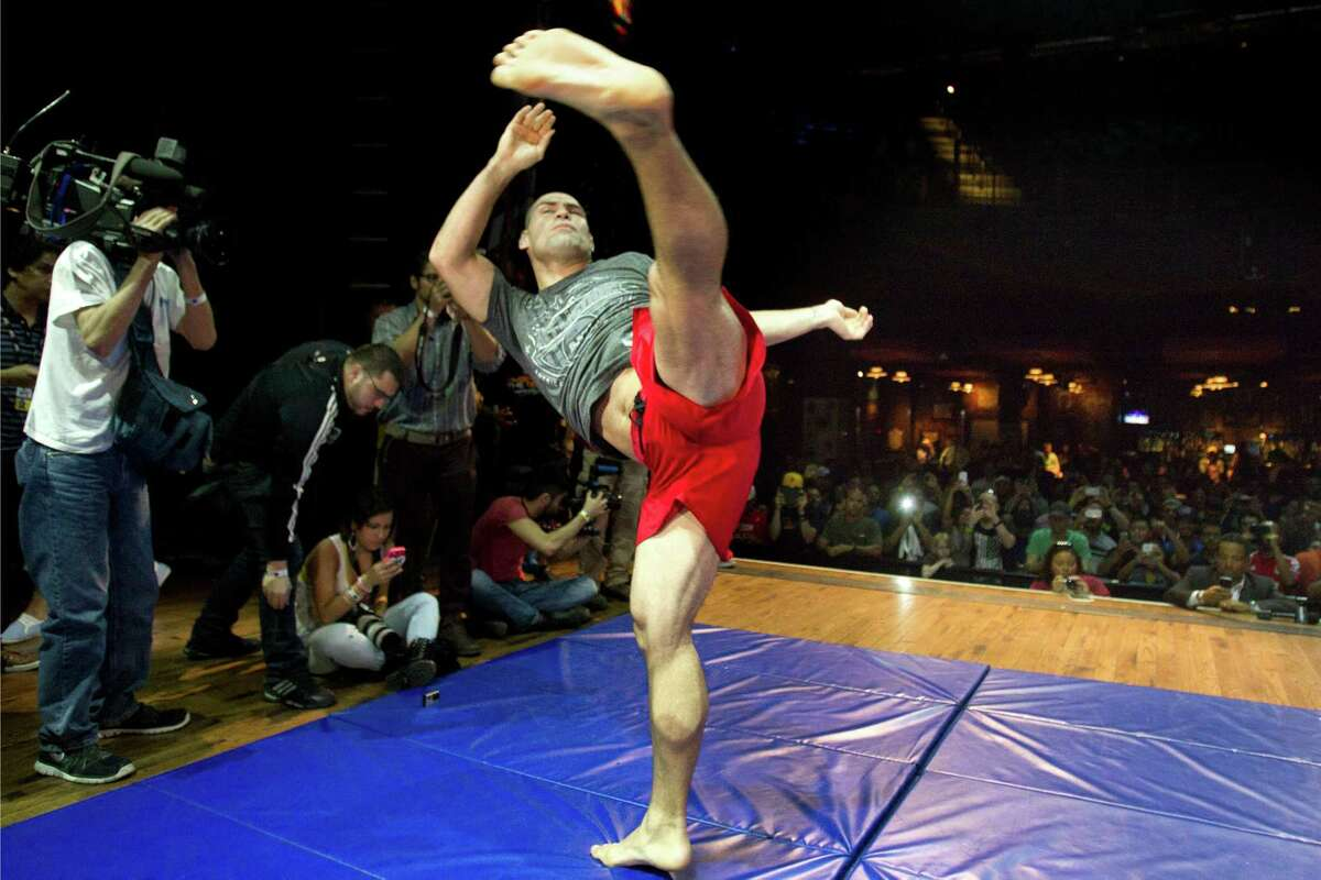 UFC heavyweight champion Cain Velasquez throws a kick during an open workout for UFC 166 at the House of Blues Wednesday, Oct. 16, 2013, in Houston. The fights are scheduled for Saturday night at Toyota Center.