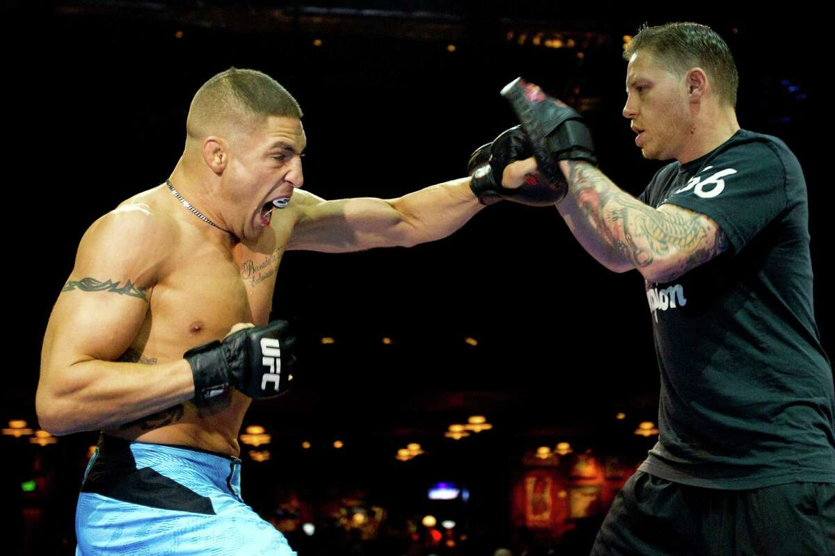 Diego Sanchez throws a punch during an open workout for UFC 166 at the House of Blues Wednesday, Oct. 16, 2013, in Houston. The fights are scheduled for Saturday night at Toyota Center.