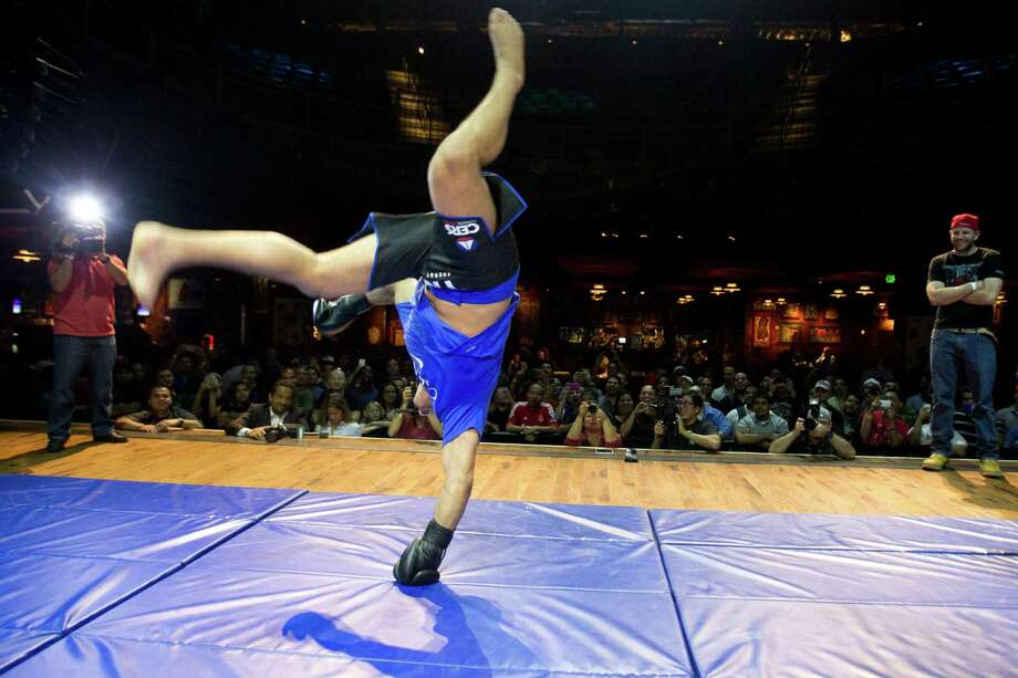 Junior Dos Santos does a cartwheel at the end of his workout during an open workout for UFC 166 at the House of Blues Wednesday, Oct. 16, 2013, in Houston. Photo: Brett Coomer, Houston Chronicle / © 2013 Houston Chronicle