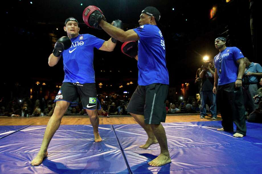 Junior Dos Santos, left, throws a punch as he works out with Luiz Dorea during an open workout for UFC 166 at the House of Blues Wednesday, Oct. 16, 2013, in Houston. The fights are scheduled for Saturday night at Toyota Center. Photo: Brett Coomer, Houston Chronicle / © 2013 Houston Chronicle