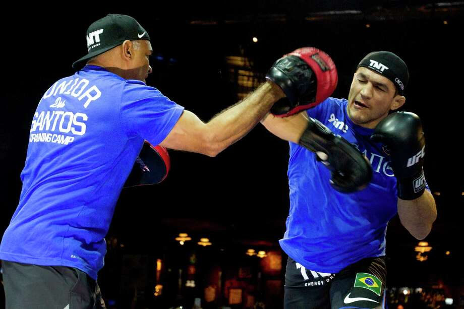 Junior Dos Santos, right, throws an elbow as he works out with Luiz Dorea during an open workout for UFC 166 at the House of Blues Wednesday, Oct. 16, 2013, in Houston. The fights are scheduled for Saturday night at Toyota Center. Photo: Brett Coomer, Houston Chronicle / © 2013 Houston Chronicle