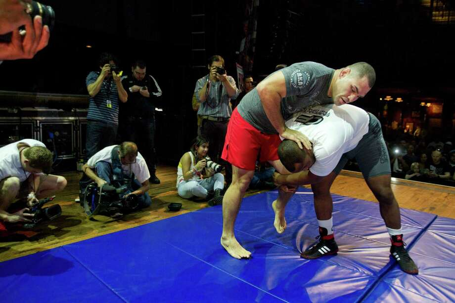 UFC heavyweight champion Cain Velasquez , left, works out with Daniel Cormier during an open workout for UFC 166 at the House of Blues Wednesday, Oct. 16, 2013, in Houston. The fights are scheduled for Saturday night at Toyota Center. Photo: Brett Coomer, Houston Chronicle / © 2013 Houston Chronicle