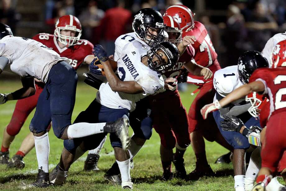 Mike Ross Connecticut Post freelance - Ansonia High School's captain #2 Arkeel Newsome comes up short during an two point conversion attempt during Friday evening match-up against Derby High School. Ansonia would remain un-defeated and winning the game 62-28. Photo: Mike Ross / Mike Ross Connecticut Post freelance - @www.mikerossphoto.com