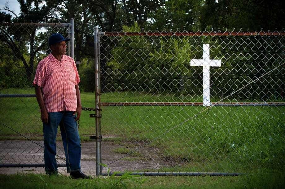 Woodrow Jones wears many hats - caretaker, historian, administrator - at the  Harrisburg-Jackson Cemetery, where many black pioneers of the area lie buried. Photo: Marie D. De Jeséºs, Staff / © 2013 Houston Chronicle