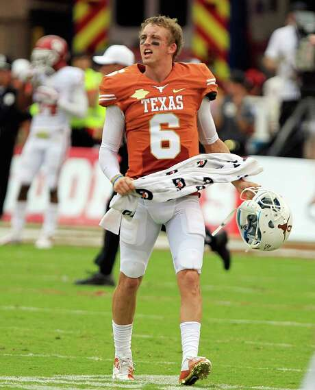 Texas quarterback Case McCoy (6) celebrates after a Longhorns' touchdown during the first quarter. The Texas Longhorns defeated the Oklahoma Sooners, 36-20, at the Cotton Bowl in Dallas, Texas, on Saturday, October 12, 2013. (John Rhodes/Fort Worth Star-Telegram/MCT) Photo: John Rhodes, MBR / Fort Worth Star-Telegram