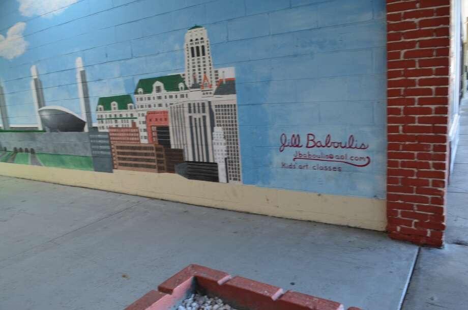 Artist of mural Photo: Audrey Goodemote