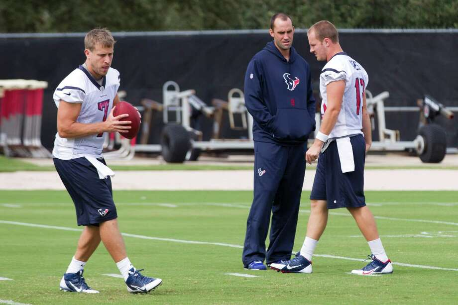 Matt Schaub, center, was reduced to an advisory role at Wednesday's practice as Case Keenum, left, and T.J. Yates shared duties. Photo: Brett Coomer, Staff / © 2013  Houston Chronicle