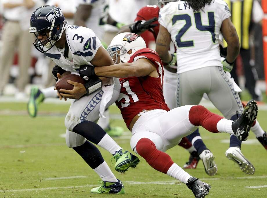 But first ... the last time they met in Arizona:  Sept. 9, 2012 – Seahawks 16, at Cardinals 20  It was the first game of the 2012 season and Russell Wilson's first-ever game in the NFL -- as a rookie starting quarterback, no less. He had just won the job over Matt Flynn and Seattle fans didn't know much about him. What they saw was a shell of the quarterback Wilson would become, limited in the first half of the season to a smaller playbook and fewer passing plays. Wilson finished his professional debut 18-for-34 with 153 passing yards, a touchdown and an interception.  Cardinals starter John Skelton got knocked out of the game in the fourth quarter, when the Hawks led 16-13, after he was sacked by Seattle's Chris Clemons. But Arizona backup Kevin Kolb shocked the Seahawks defense by immediately leading a 68-yard touchdown drive to give Arizona the lead. Wilson couldn't pull off a comeback in his first-ever NFL game, and the Seahawks left with their sixth loss in their past seven trips to Arizona. Photo: Ross D. Franklin, Associated Press