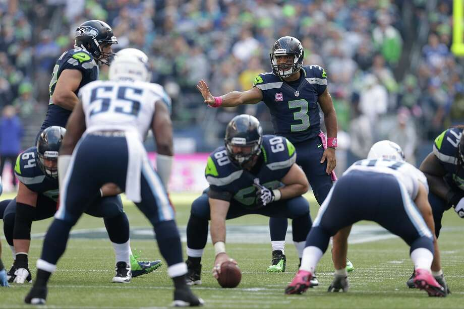 2. Has the offensive line really improved?  Still injured are both of Seattle's starting tackles, Russell Okung and Breno Giacomini, and still a big question mark is Seattle's offensive line. It's been the team's most apparent weakness all year -- left guard Paul McQuistan had to slide over to Okung's spot at left tackle, backup James Carpenter took over for McQuistan, rookie Michael Bowie has been playing for Giacomini, and defensive-lineman-turned-right-guard J.R. Sweezy remains a weak link in Seattle's pass and run protection. Nevertheless, the patchwork O-line has been improving.  Against Tennessee on Sunday at CenturyLink Field, starting center Max Unger (pictured, No. 60) returned from his arm injury and took back over for backup Lemuel Jeanpierre -- and while we are not saying Jeanpierre was the problem, Seattle's offensive line looked much more capable against the Titans. Russell Wilson still had to roll out of trouble on many passing plays, but he got more chances to sit back in the pocket to find an open receiver. Perhaps most improved is Bowie, who has grown in leaps and bounds, and may even now be challenging Giacomini for the starting job.  Watch closely Thursday whether the pressure is further lifted off Wilson, and whether the O-line can continue its success in opening running lanes for Marshawn Lynch, who had 155 all-purpose yards (77 rushing, 78 receiving) against Tennessee. Photo: Elaine Thompson, Associated Press / AP2013