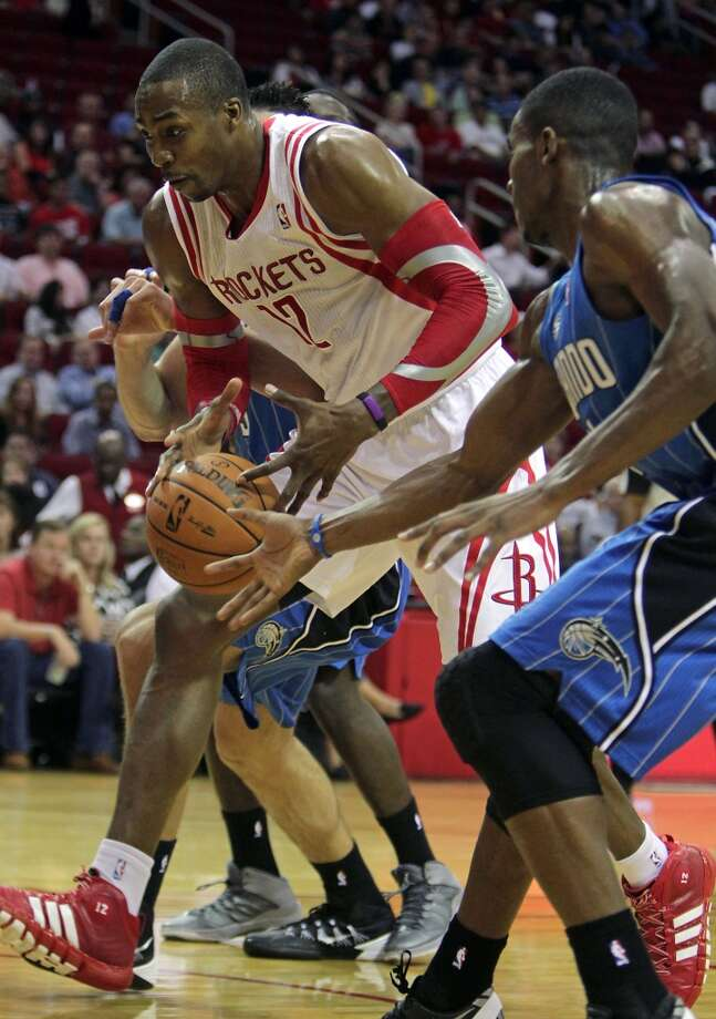 Oct. 16: Rockets 108, Magic 104Houston Rockets center Dwight Howard right, and Orlando Magic small forward Maurice Harkless right, during first quarter of NBA preseason game action at the Toyota Center Wednesday, Oct. 16, 2013, in Houston.  ( James Nielsen / Houston Chronicle ) Photo: James Nielsen, Houston Chronicle